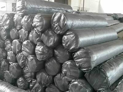 Rolls of silt fence fabrics are packed in black woven bags.