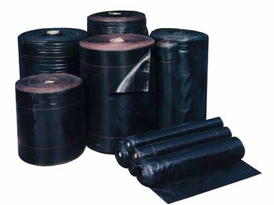 There are rolls of non-woven silt fence fabric in black.