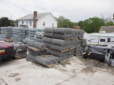 Rolls of chain link wire meshes for silt fencing are stored in the warehouse.