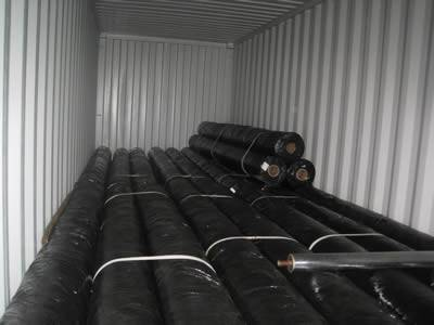 Rolls of silt fence fabrics are placed on a truck and ready to deliver.