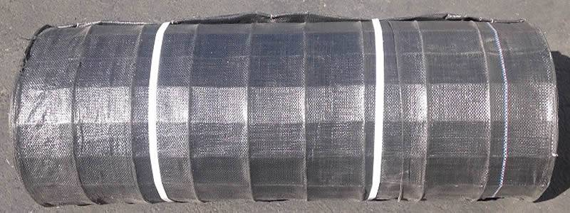 A roll of gray wire backed silt fence tied with white packing belts is taken pictures from two angles.