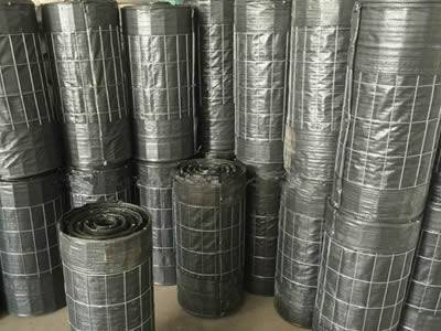 Wire backed silt fences are stored in the warehouse.